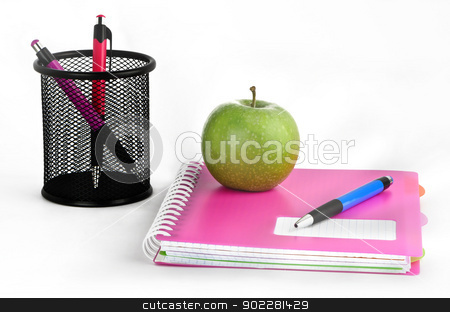 Stationery stock photo, Three colored pens, notepads and green apple on a white background by aviemil
