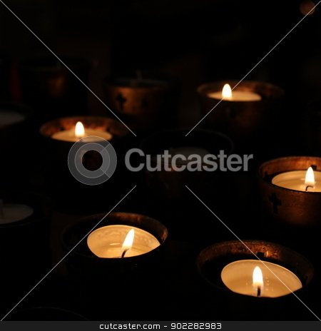 Church Candles stock photo, Candles in a church on black background by Henrik Lehnerer