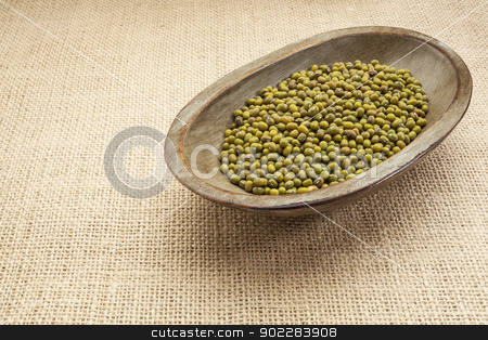 mung beans stock photo, mung beans in a rustic wood bowl against burlap canvas by Marek Uliasz