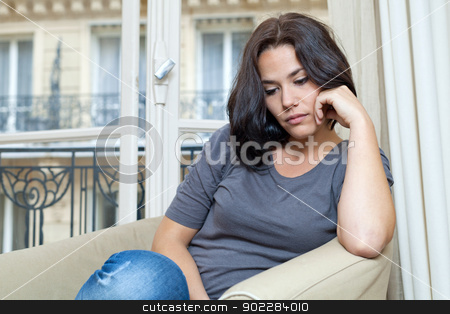 Young woman and sadness stock photo, Portrait of a nice woman thinking and looking sad by tristanbm