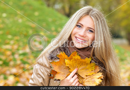 Happiness in autumn stock photo, Closeup portrait of a nice woman with leaves of autumn by tristanbm