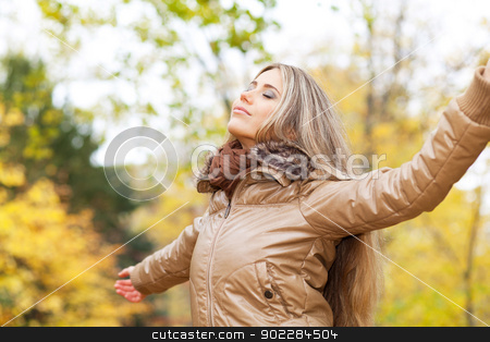 Serene autumn woman stock photo, Young woman opening her arms and breathing in a park by tristanbm