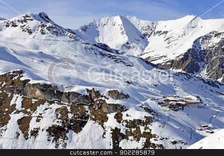 Ski station near Hintertux Glacier stock photo, Zillertal Alps at Hintertux Glacier with a cable car station, ski lifts and pistes in sunset light by Krzysztof Nahlik