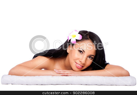 Woman at holiday spa stock photo, Beautiful happy female face, woman laying relaxing on white towel at holiday spa massage beauty treatment parlor. Healthy Skincare concept, isolated. by Paul Hakimata