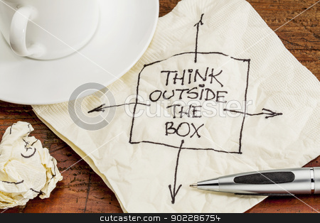 think outside the box stock photo, think outside the box - black pen drawing on a cocktail napkin with a coffee cup on a table by Marek Uliasz