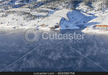 fog over mountain lake stock photo, fog over mountain lake - Horsetooth Reservoir near Fort Collins, Colorado at early winter by Marek Uliasz