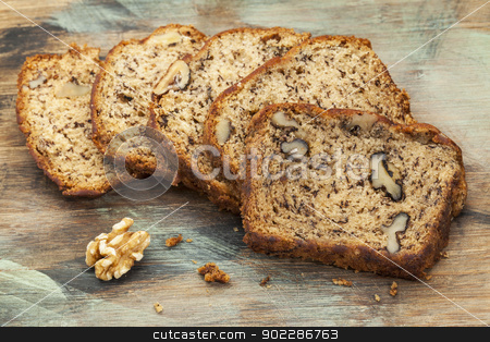 banana bread with walnut stock photo, slices of fresh banana bread with walnut on a cutting board by Marek Uliasz