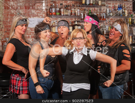 Female Gang Laughing at Funny Nerd stock photo, Female motorcycle gang laughing at nerd in bar by Scott Griessel