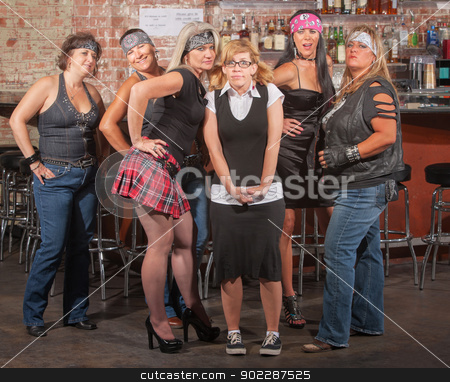 Nervous Nerd with Gang in Bar stock photo, Nervous nerd lady in between gang of tough women in bar  by Scott Griessel