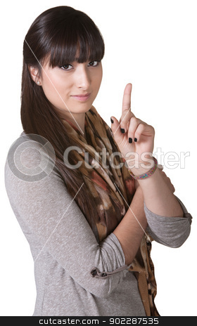 Woman Pointing Up stock photo, Pretty young Hispanic female pointing index finger up by Scott Griessel