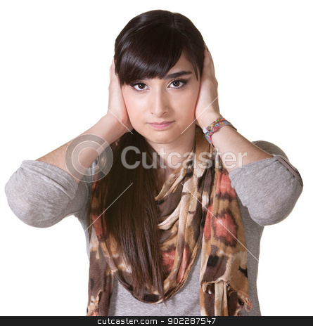Female with Hands Over Ears stock photo, Beautiful young Hispanic female covering ears over white background by Scott Griessel