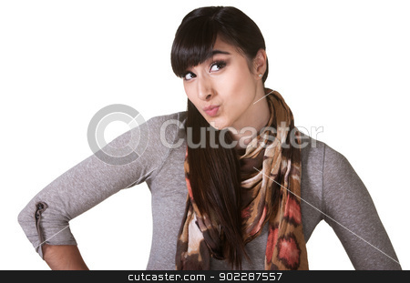 Female Puckering Her Lips stock photo, Beautiful young Hispanic female puckering her lips by Scott Griessel