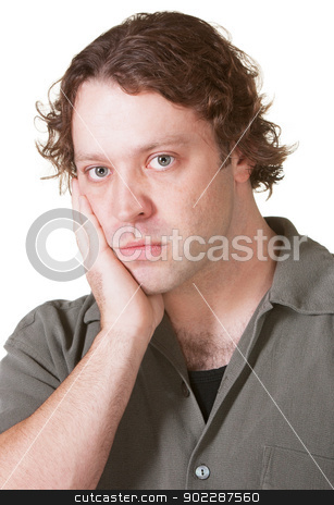 Man with Blank Stare stock photo, Young Caucasian male over isolated background staring ahead by Scott Griessel