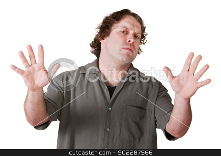 Man with Palms Out stock photo, Suspicious man with arms and hands out on isolated background by Scott Griessel