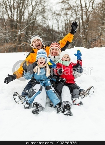 Family having fun stock photo, Attractive family having fun in a winter park by Grafvision
