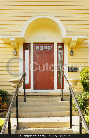Magenta Door yellow home stock photo, Magenta Home door bordered windows and a yellow painted home by bobkeenan