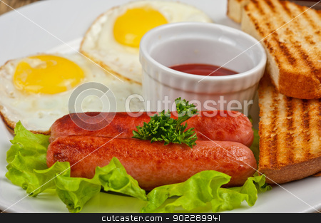 Fried eggs with sausages stock photo, Fried eggs with sausages, toasts, greens and sauce by olinchuk