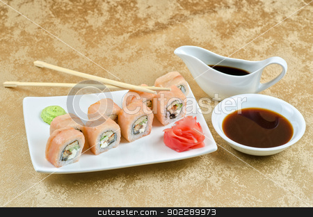 shrimp and eel sushi roll stock photo, sushi roll of shrimp, eel, cucumber, pepper and sauce by olinchuk