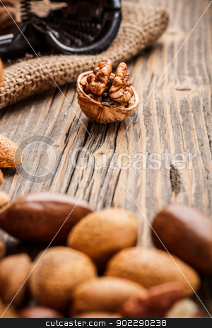 Nuts stock photo, Nuts on rustic wooden table by Grafvision