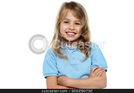 Young girl child with hands crossed stock photo, Charming young girl standing before the camera with her arms folded. by Ishay Botbol