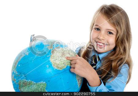 Disciplined child pointing at something on globe stock photo, Smiling girl student pointing at something over the globe. by Ishay Botbol