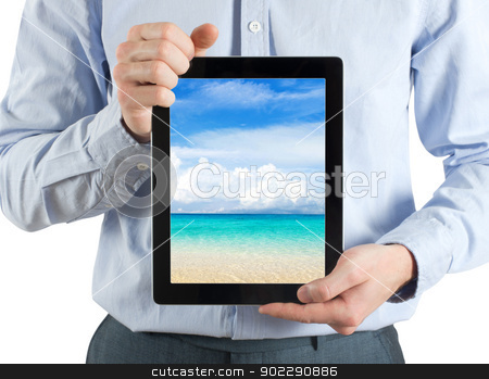 tablet computer stock photo, hands are holding the tablet computer by Vitaliy Pakhnyushchyy