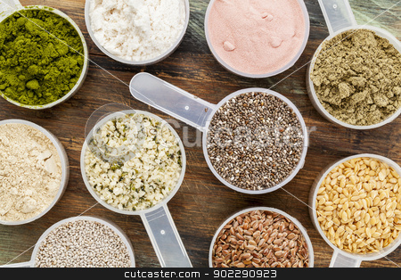 scoops of superfood stock photo, scoops of superfood - healthy seeds and powders (white and brown chia, brown and golden flax, hemp, pomegranate fruit powder, wheatgrass, hemp and whey protein, maca root) - top view by Marek Uliasz