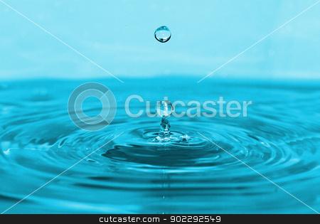 splash of blue water stock photo, The round transparent drop of water falls downward by Vitaliy Pakhnyushchyy
