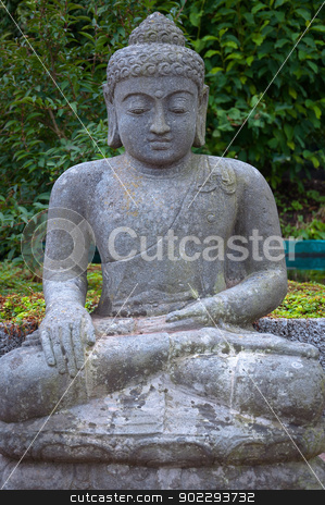 Stone Buddha in the lotus position. stock photo, Sitting stone statue of the god Buddha sitting in lotus position. by Borys Shevchuk