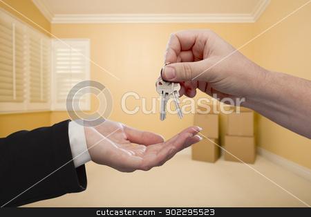 Handing Over the House Keys Inside Empty Room stock photo, Handing Over the House Keys To A New Home Inside Empty Room. by Andy Dean
