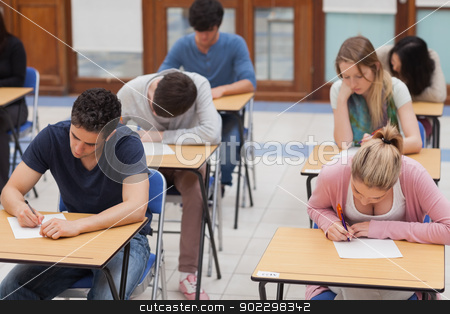 Students sitting a test stock photo, Students sitting a test in an exam hall in college by Wavebreak Media