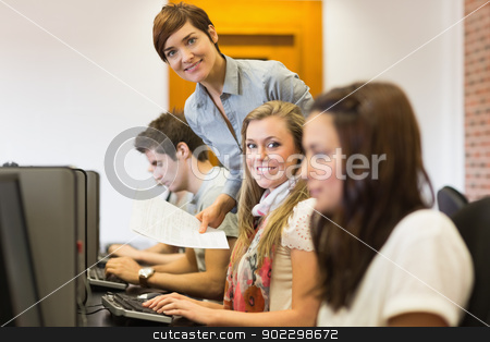 Student and teacher smiling at the computer room  stock photo, Student and teacher smiling at the computer room of the university by Wavebreak Media