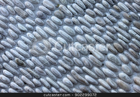 Pebbles Stone Wall stock photo, Small gray pebbles stone wall for background. by Henrik Lehnerer