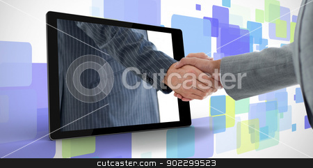 Businessman reaching out from tablet and shaking hands with othe stock photo, Businessman reaching out from tablet and shaking hands with other man on purple digital background by Wavebreak Media