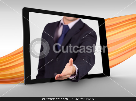 Businessman reaching out from tablet to shake hands stock photo, Businessman reaching out from tablet to shake hands on orange wave background by Wavebreak Media