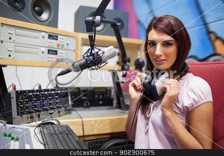 Gorgeous woman posing stock photo, Gorgeous woman posing in a studio by Wavebreak Media