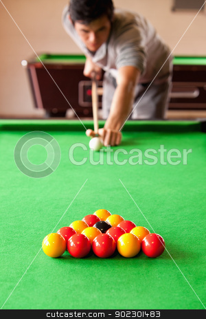 Portrait of a man playing snooker stock photo, Portrait of a man playing snooker with the camera focus on the balls by Wavebreak Media
