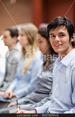 Portrait of a businessman smiling at the camera stock photo, Portrait of a businessman smiling at the camera during a presentation by Wavebreak Media