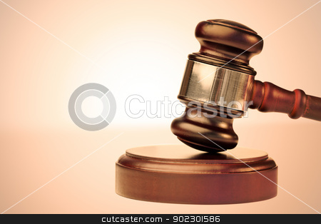 Close up of a brown gavel stock photo, Close up of a brown gavel against a lighted background by Wavebreak Media