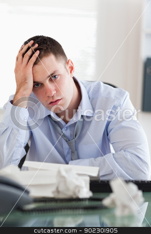 Close up of businessman being overextended with his accounting stock photo, Close up of frustrated businessman being overextended with his accounting by Wavebreak Media
