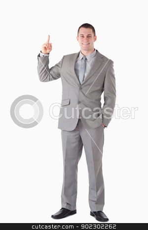 Portrait of a businessman pointing at a copy space stock photo, Portrait of a businessman pointing at a copy space against a white background by Wavebreak Media
