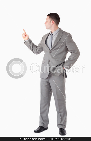 Portrait of a businessman pointing at something stock photo, Portrait of a businessman pointing at something against a white background by Wavebreak Media