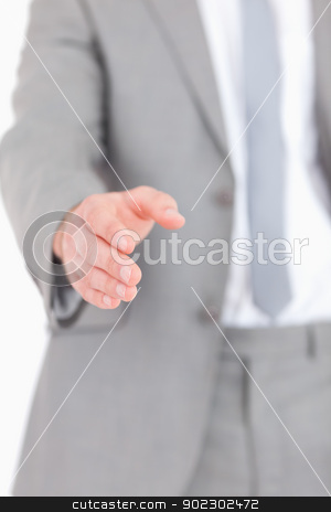 Portrait of a masculine hand ready for a handshake stock photo, Portrait of a masculine hand ready for a handshake against a white background by Wavebreak Media