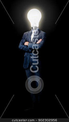 Lamp head businessman stock photo, Lamp head businessman against a black background by Wavebreak Media