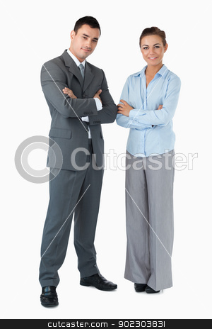 Business partner with arms folded against a white background stock photo, Confident business partner with arms folded against a whit background by Wavebreak Media