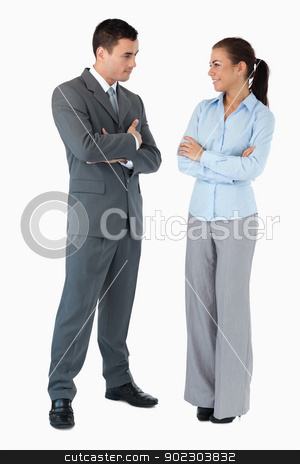 Business partner looking at each other against a white backgroun stock photo, Confident business partner looking at each other against a white background by Wavebreak Media