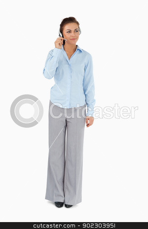 Businesswoman listening to caller with headset on stock photo, Businesswoman listening to caller with headset on against a white background by Wavebreak Media