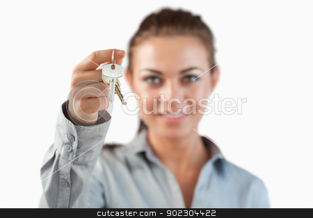 Close up of keys being held by female estate agent stock photo, Close up of keys being held by female estate agent against a white background by Wavebreak Media