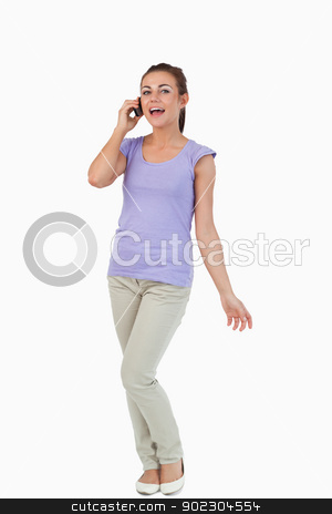 Young female on the phone stock photo, Young female on the phone against a white background by Wavebreak Media