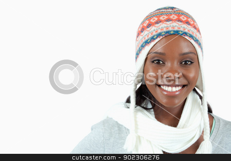 Smiling young woman with winter clothes on stock photo, Smiling young woman with winter clothes on against a white background by Wavebreak Media